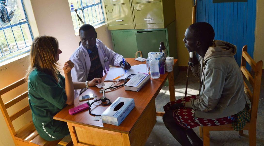 A Projects Abroad volunteer helps a local doctor in Kenya to assess a patient during her Occupational Therapy internship.